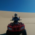 Quad biking on sand dunes with ocean views