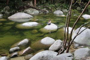 Kristi chilling on a rock at Mossman Gorge